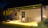 Pose de pergola à toile avec spots LED réalisée à Tours (Indre-et-Loire) par Verrier Stores et Fenêtres