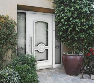 Rénovation d'une porte d'entrée vitrée à Granville (Manche) par TL Production