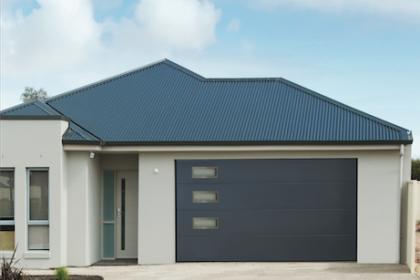 Porte de garage sectionnelle avec hublots design