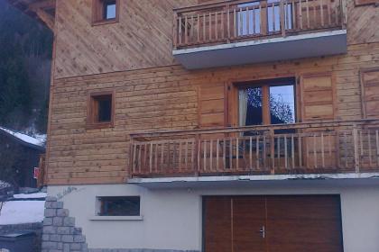 Porte de garage sectionnelle electrique morzine gypass poirtillon decor bois