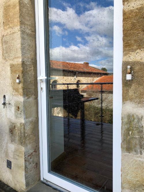 Installation d'une porte-fenêtre à Billom dans le Puy-de-Dôme par Luxastore