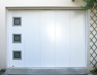 Portes de garage sur mesure komilfo - Portes de garage coulissantes motorisees ...